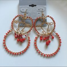 "Red beaded fashion Gold  plated  Frida earrings. Red beaded fashion Gold  plated  Frida earrings. New never worn sample, discounted because it's missing a bead but can't really notice. Measures 3"" in length Jewelry Earrings"