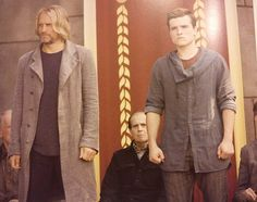 New still of Haymitch and Peeta....I love how they're standing the same way