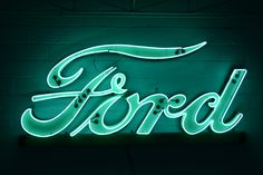 Rare Ford double row neon dealership sign in green, most Ford signs are blue.