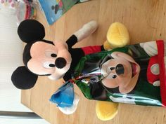 Mickey Mouse goody bags  Plush Mickey and notebook and crayons inside bag