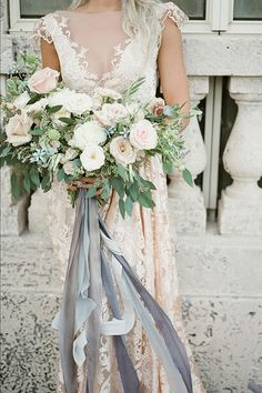 similar colors, texture and feel to bridal bouquet.  Make smaller and skip the ribbon streamers