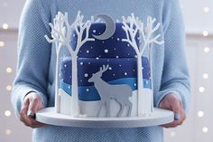Make a real showstopper this Christmas, that can be the centrepiece of your Christmas table - this stunning woodland stag cake takes inspiration from papercutting styles with the trees, and features one of our favourite new products, silver metallic fondant icing! Christmas Baking, Christmas Sweets, Christmas Cupcakes, Chrismas Cake, Fondant Christmas Cake, Christmas Cake Topper, Christmas Tree Cake, Christmas Cake Decorations, Fondant Decorations