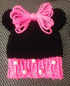 Loom Knit Minnie Mouse Hat Pattern free on the Loomahat.com website. Very easy step by step loom knitting instructions. Cute baby hat for your little girl.