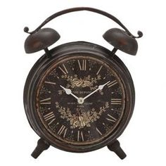 "Metal table clock.  Product: Table clockConstruction Material: MetalColor: BlackDimensions: 13"" H x 10"" W x 4"" HNote: Batteries not included"