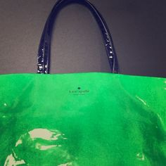 Vogue Inspired Kate Spade Great bag for the summer. Green vinyl with colorful other side. 12 inches tall and 16.5 wide. Tan Kate Spade interior. In GREAT CONDITION. Black handles. kate spade Bags Shoulder Bags