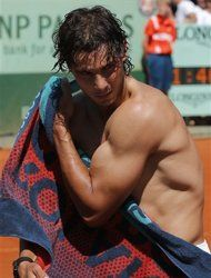 Ooh la la!  Spain's Rafael Nadal wipes his body after defeating  compatriot David Ferrer during their semifinal match in the French Open tennis tournament at the Roland Garros stadium in Paris, Friday, June 8, 2012.