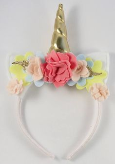 Your child will want to wear this Tropical inspired unicorn headband everyday, it is so much fun! The ears are handmade from white acrylic and the horn is made from gold metallic fabric and has polyester stuffing so it will stand up straight. The ears and horn are surrounded by tropical