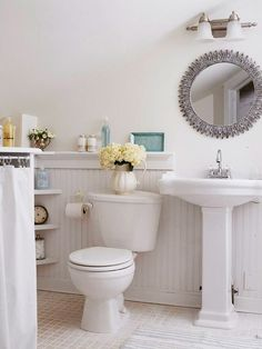 forgo the traditional medicine cabinet by spray painting a mirror frame to coordinate with your bathroom