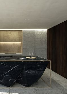 Interior design for a kitchen remodelling in an existing private residence. Featuring a sculptural kitchen island in black Nero Marquina...