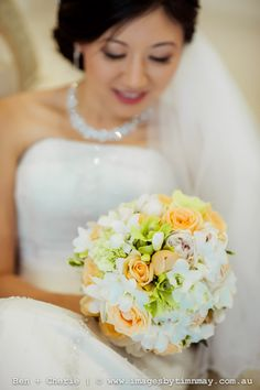 BG372   Apricot David Austin roses, green hydrangea, white and green Singapore orchid clusters