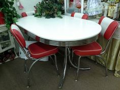 Sold - This has a oval vintage table, white top Chrome apron, base and legs. The set contains 4 matching chrome chairs, with red seat and red and white backs all in good condition. The table measures 60 inches by 36 inches. The set can be seen and booth G 17 at Main Street Antique Mall 7260 East Main St ( E of Power Rd ) Mesa 85207  480 9241122 open 7 days 10 till 530 Cash or charge 30 day layaway also available