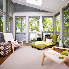 Sunroom / Enclosed porch, wood plank floors, skylight, gray siding, contemporary furnishings, tan, avocado green, outdoor rug, midcentury eclectic