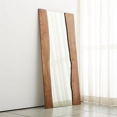 Shop Live Edge Large Floor Mirror.  Long lengths of live-edge acacia planks bracket this grand-scaled, freestanding mirror with the organic richness of natural wood.  Wood will vary in shape, graining and color.