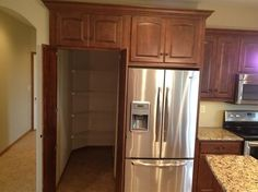 Walk-in pantry behind the fridge!! wayyyy cool! I want a hide the dishes room too!