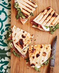 Prosciutto-Mozzarella Piadina -- Piadina is a pan-grilled sandwich made with a quick baking-powder flatbread. (If youre in a rush you could use a flour tortilla instead.) This recipe is from Casa Olivi in Le Marche. Prosciutto, Flatbread Sandwiches, Wrap Sandwiches, Recipes With Mozzarella Cheese, Cheese Recipes, Burrata Cheese, Wine Recipes, Cooking Recipes, Sandwich Recipes