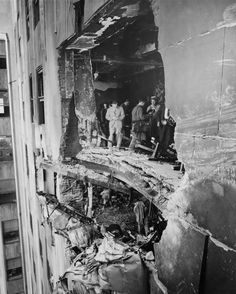 Bomber Rammed Into Empire State Building. A view of the hole rammed into the and stories of the Empire State Building by a U. Army Bomber flying in the fog. Part of the wreckage hangs from the story, New York, New York, July © Bettmann World Trade Center, Empire State Building, Old Pictures, Old Photos, Amazing Pictures, Vintage Photographs, Vintage Photos, Photo New York, New York City