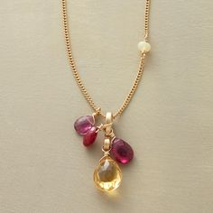 "BEYOND CITRINE NECKLACE�--�A ruby and citrine necklace, wherein those two gemstones pair up with pink tourmaline and opal, clustering around a figure-eight pendant, clinging to 14kt goldfilled links. Exclusive. Handmade in USA by�Thoi Vo. Lobster clasp. 16"" to 19""L."
