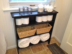 DIY slim bathroom storage shelf. Other neat tutorials on here too.