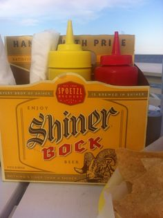 6 pack bottle holder as napkin and condiments holder. Saw this on a seaside cafe and bar, super cute and cheap!