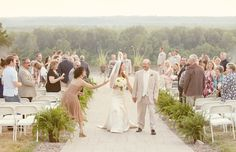 """Bride and groom exiting the ceremony with """"helicopter"""" seeds from nearby Oak trees as the confetti!  Photography from a rustic outdoor wedding at one of our favorite mid-Missouri venues... the Les Bourgeois Winery in Rocheport, MO (super close to Columbia!)"""