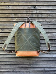 Waxed canvas rucksack/backpack with roll up top and oiled