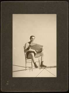 "Ivan H. Luce, Aerialist William Witaschek, ""The Great Calvert"" reading newspaper on the high wire, ca. 1910, gelatin silver print, George Eastman House Collection."