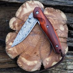 This BucknBear Folding Knife embraces the classic folder with its lines, style and craftsmanship. The rain drop Damascus folder features with a hollow grind, an elongated nail clip, and standard blade style. The elegant handle features Sandalwood.