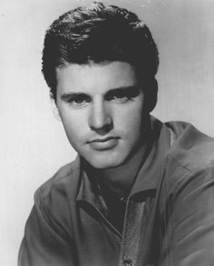 """Ricky Nelson (1940 –1985) was an American actor, musician & singer-songwriter. He starred alongside his family in the television series, The Adventures of Ozzie & Harriet (1952–66), as well as co-starring alongside John Wayne & Dean Martin in Howard Hawks's western feature film, Rio Bravo (1959). He placed 53 songs on the Billboard Hot 100 between 1957 & 1973 including """"Poor Little Fool"""".  Nelson was killed in an airplane crash on December 31, 1985."""