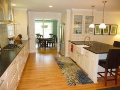 features a farmhouse sink located in the kitchen island | Yelp