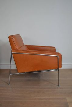 Pair of Arne Jacobsen Leather Series 3300 Lounge Chairs | From a unique collection of antique and modern sofas at https://www.1stdibs.com/furniture/seating/sofas/