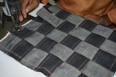 The chess board look evolving as the interlacing of the #selvedge #handloom #denim fabric strips continue on vintage style manually operated foot pedal machine.  Exclusive Hand-stitched Cushion Cover in the making..... This cushion cover is made from eco-friendly handloom denim, and is completely hand-stitched on a foot pedal operated vintage sewing machine, by a seasoned tailor.  The chess-board design, made by interlacing strips of denim fabric, is an ever-green design, and has a mesmerizi