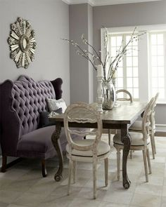 purple tufted settee, dining room, sunburst mirror