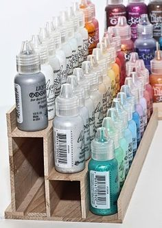Great storage idea. Made from wood sticks a little larger than Popsicle sticks. http://marthescorner.blogspot.com/2011/10/how-i-organize-my-liquid-pearls.html