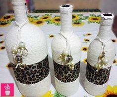 Fios e oncinha na decor das garrafas
