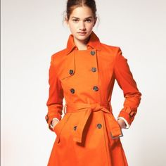 Authentic Michael Kors Orange Trench Coat Spring into he rainy season with this gorgeous orange coat! Pairs well with jeans and skirts alike and is waterproof! Includes a hood and belt for the ultimate stylish rainy day look! Michael Kors Jackets & Coats Trench Coats