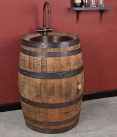Whiskey Barrel vanity with copper sink... how cool would this be for an extra bath in the game room or something... even in the garage...