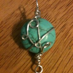 Turquoise cabochon wrapped in silver plated wire great on a silver necklace or leather cord.