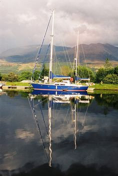 Reflections, boat moored up at the start of Caledonian Canal in Scotland