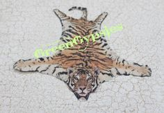 Etsy listing at https://www.etsy.com/listing/123986731/miniature-tiger-skin-rug-for-dollhouse $10.00