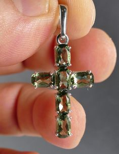 Very nice looking silver cross pendant with 6 faceted Moldavites,overall size is about 37 mm.This item is available in multiple quantity,each pendant is more less same.Price is per one piece.For sale 145 USD Sterling Silver Earrings, Silver Jewelry, Organic Glass, Cute Jewelry, Cross Pendant, Belly Button Rings, Pendants, Jewels, Accessories
