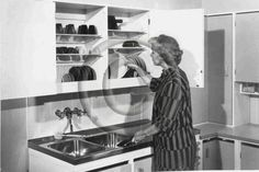 Finnish Kitchen: dish drying drainer in closet.  1940s efficiency study