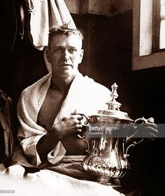 Sport, Football, 1928 FA Cup Final, Wembley, London, England, 21st April 1928, Blackburn Rovers 3 v Huddersfield Town 1, Blackburn Rovers' captain Harry Healless is pictured in the dressing room holding the FA Cup trophy