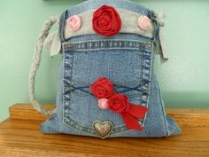Blue Jean Handbag....made from a pair of recycled jeans, fabric scraps, and tee shirt.  Small size is perfect for little girls.