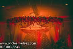 Wedding Decor by Ravi Verma in Gujarati Wedding in Wedding in the Skylands, Nj. Gujarati Wedding. Bridal Makeup by Cinderella Bridez. Best Wedding Photographer PhotosMadeEz, Award winning photographer Mou Mukherjee.