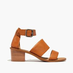 "Sleek and minimalist, this strappy leather sandal has a chunky block heel to make it extra-comfortable. Please note: When you select your size, ""H"" equals a half size. <ul><li>Leather upper and lining.</li><li>2 1/4"" stacked heel.</li><li>Man-made sole.</li><li>Import.</li></ul>"