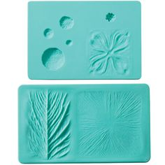 Flower Impression Mat Set  Give your gum paste flowers incredible texture and detail with the Wilton Flower Impression Set. This 2-piece silicone mold set is the perfect complement to the Wilton Gum Paste Flower Cutter Set to give you the tools you need to achieve beautiful gum paste flowers that are reflective of nature's beauty. Varieties of specific flower details are included on the inside of this package for leaf and petal veining details and flower centers.    Units:2 piece set…