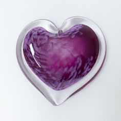 Plum Parfait by April Wagner. This hot sculpted handmade glass heart paperweight evokes thoughtful emotion in the viewer. Layers of swirling color reference nature and are a pleasure to enjoy in one's home or office. Signed and dated on the bottom, there is also a heart shape stamped into the center of the bottom. Each piece is unique and slight variation in color patterning from piece to piece is to be expected. Size varies from 3