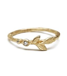 Enchanting! Our favorite twig stack ring seems like it was charmed by a pixie. Textured leaves and 2 twinkling dew drops accented by diamonds (0.02 cttw) raise ever so slightly above the band's profile, allowing it to mix in with different styles.   stacking ring, stack ring, stackable ring, wedding band,  yellow gold ring