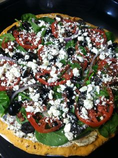 """Greek pizza My daughter won 1st prize in the no bake pizza contest at the ga national fair with this recipe! Start with a pre baked crust ( we used an herb crust) Use ricotta and basil pesto combined for your """"sauce"""" Layer baby spinach, cooked crumbled bacon, black olives, thin sliced red onion, thin tomatoes, crumbled feta and Mexican crumble cheese, sprinkle balsamic vining at and drizzle honey!    Best """"light"""" pizza ever!"""