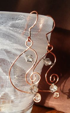 Check out this item in my Etsy shop https://www.etsy.com/listing/213890026/1-34-curvy-wrapped-swavorski-dangles